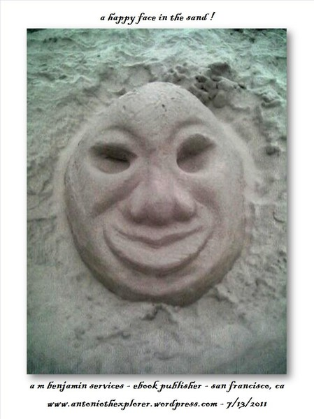 a happy face in the sand !
