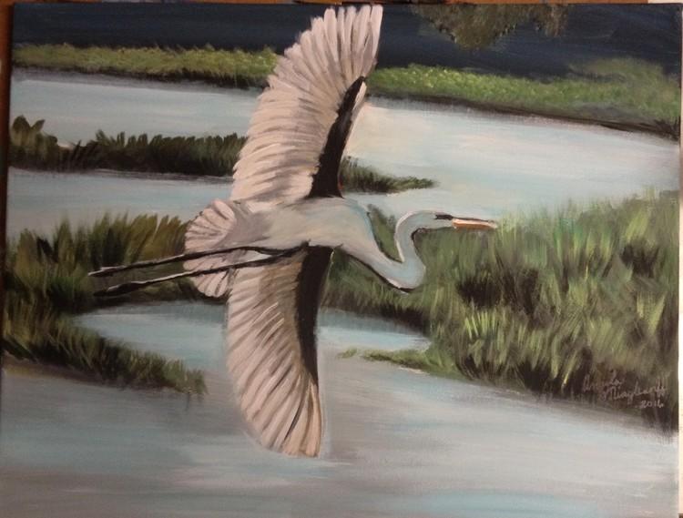 Egret over water