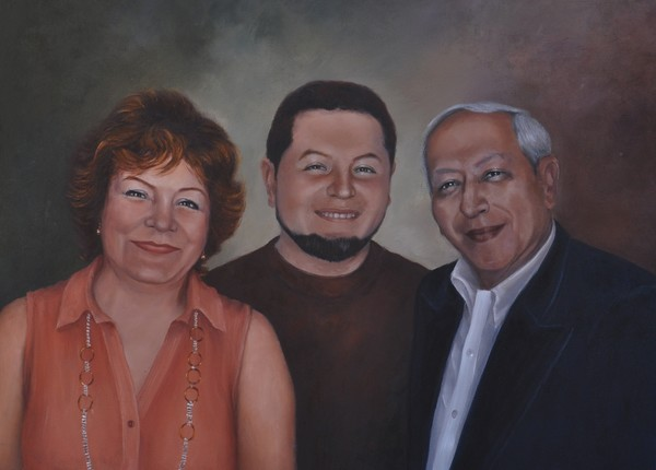 Dr. O. Robles, wife, and son.