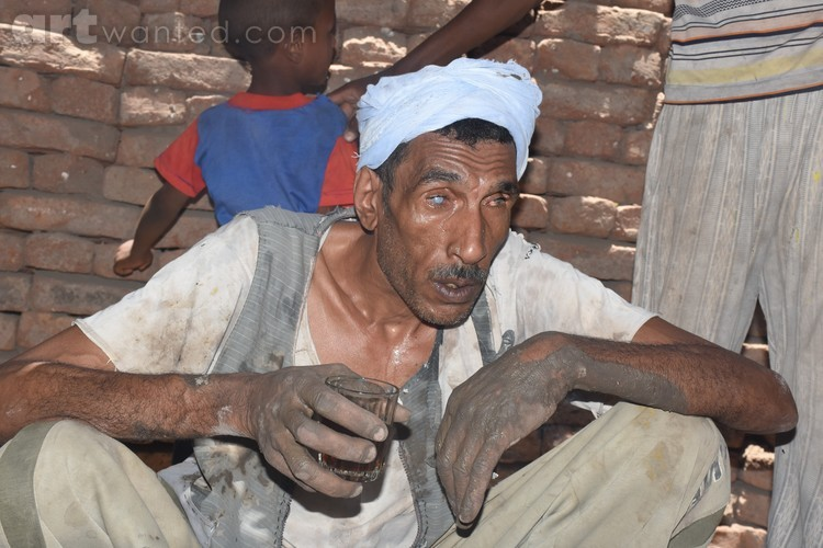 A blind Egyptian working in the manufacture of pot