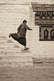 Novice Monk Running Down Stairs