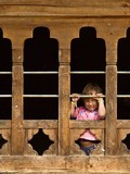 Bhutan, Child in Farm House Window