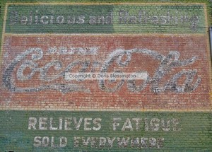 Coca Cola Sign on Brick Wall