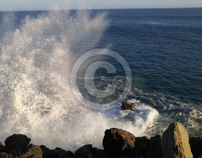 Ocean waves crash on rocks