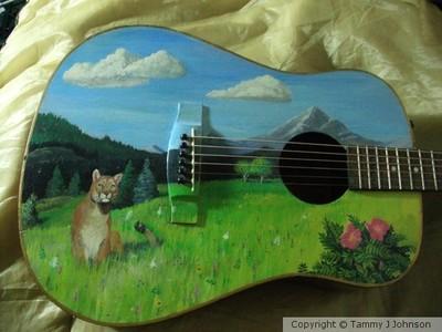 Mountain lion on guitar,