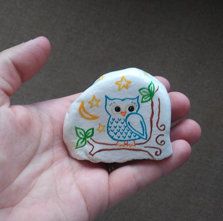 Hand painted rock art stone owl in tree