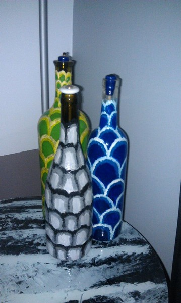 painted wine bottles with candle wicks oil paint on glass