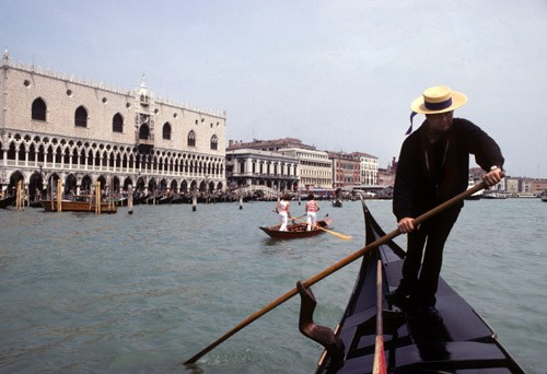 Gondolier on Grand Canal, Venice, Italy