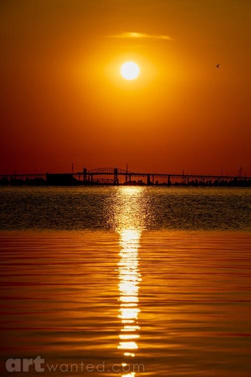 The sun shines onto the lake