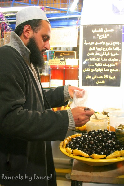 Buying Olives at the market in the Medina