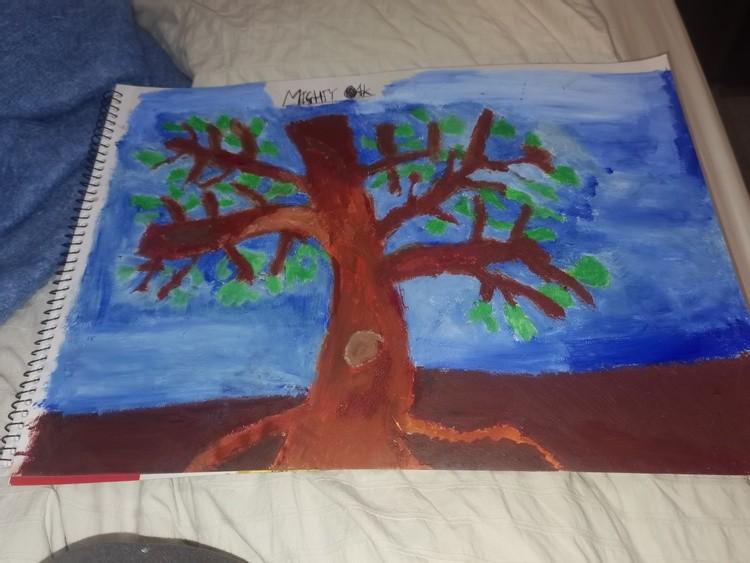 Oak tree standing tall in the landscape