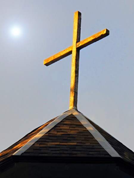 Cross on a Roof Top
