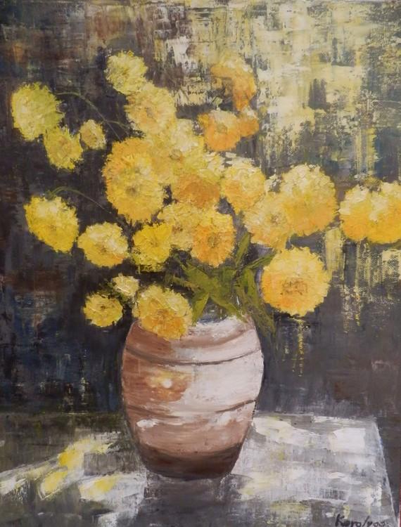Yellow flowers in terracotta pot