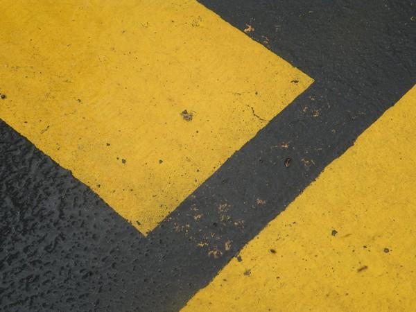Desending yellow arrow