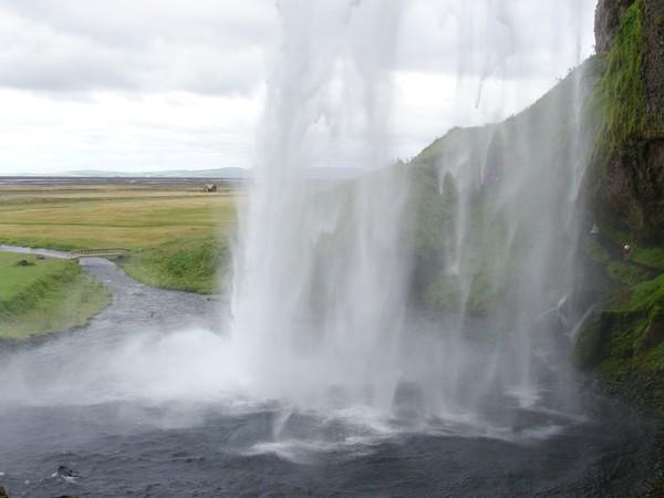 Seljalandsfoss - Behind the waterfall, in Iceland