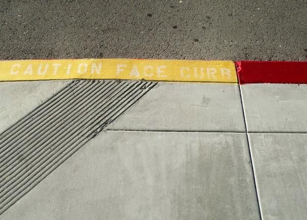 Caution- Face Curb