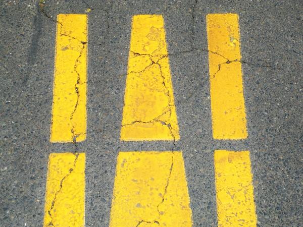 Three gold lines on Asphalt