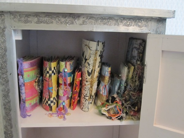 Hand Made Books in Silver Cabinet