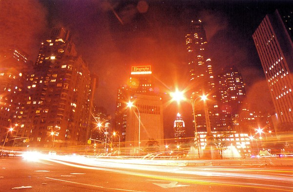 MID-MANHATAN AT NIGHT