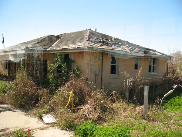 HOUSE DAMAGED IN HURRICANE YEAR'S LATER
