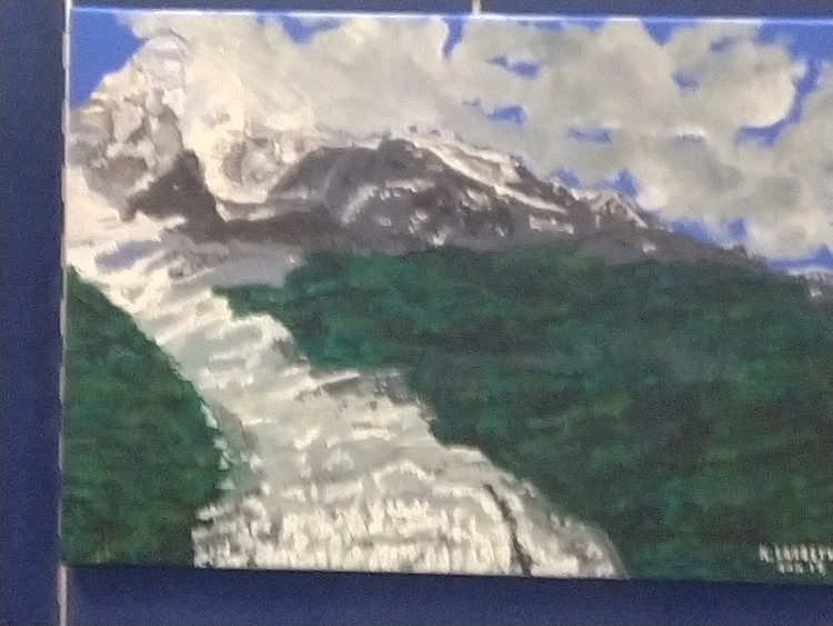 Mountain landscape with a glacier and forests