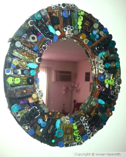 MIRROR WITH LEATHER COLLAGE FRAME