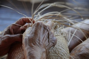 The hands of a master weaver.