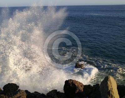 Ocean waves crash on rocks
