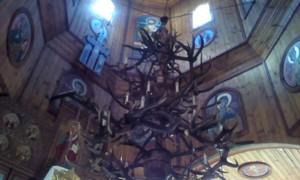 Stag horns candelabrum in mountain village