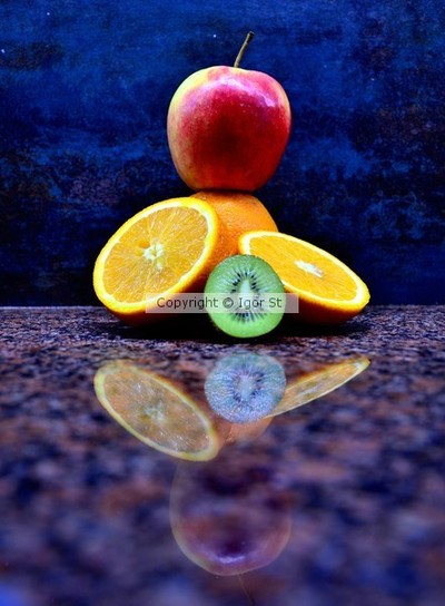 apple, orange, kiwi , table , reflection