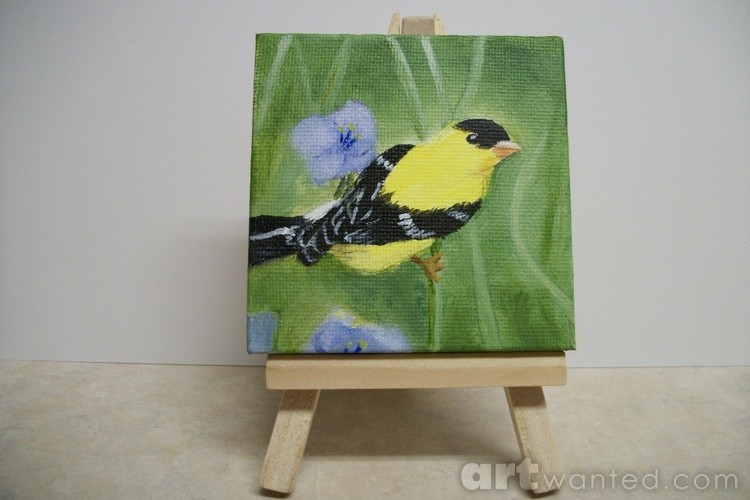 Yellow Finch among the flowers