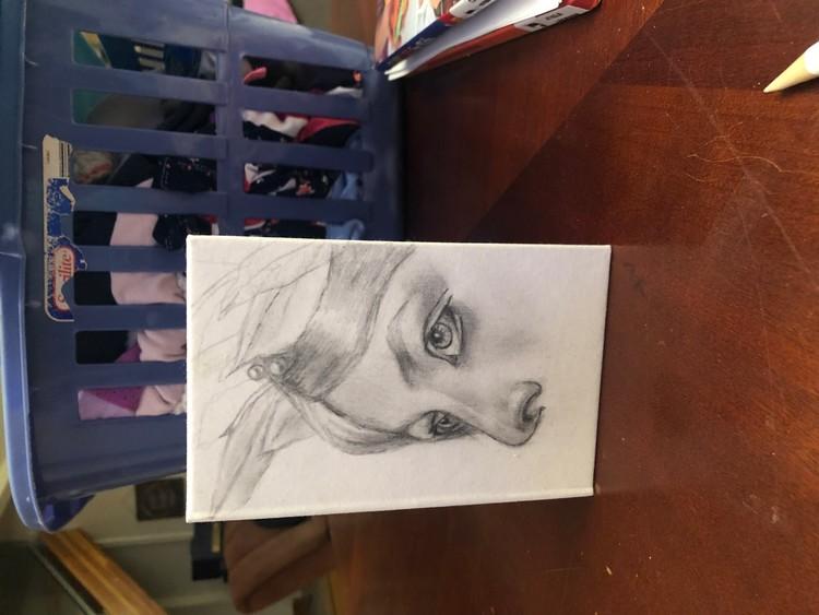 Sketch of young girl on sketchbook